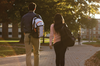 Two Students Walking on College Campus