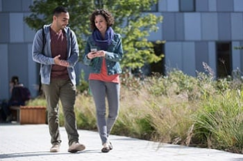 Two Students Walking on Campus