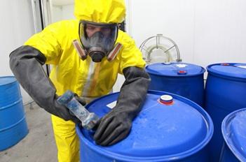 facilities worker in hazmat suit