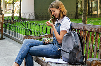 student on a bench