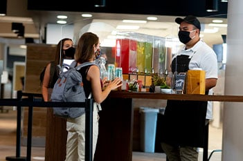 student waiting in line for beverage