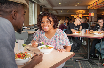 students eating and smiling